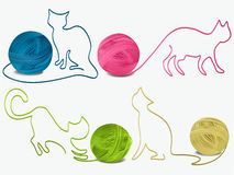 Abstract wool cats. Four balls of wool with cat silhouette Stock Photo