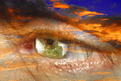 Abstract world in iris in flames. World in iris in fiery cloudscape Stock Photography
