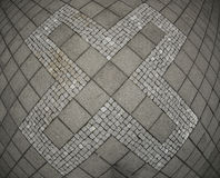 Abstract X symbol on concrete tile Stock Image
