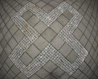 Abstract X-symbool op betontegel Stock Afbeelding