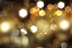 Abstract xmas background. Abstract background with gold blurred lights Royalty Free Stock Photo
