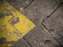 Abstract yellow arrow. On the road Stock Photos