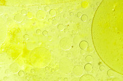 Abstract yellow background with oil and water Royalty Free Stock Photo