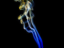 Abstract yellow-blue smoke from aromatic sticks. Stock Image