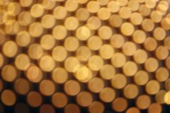 Abstract yellow bokeh defocused background. Colored lights blur gold balls background royalty free stock image