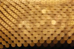 Abstract yellow bokeh defocused background. Colored lights blur gold balls background stock photos
