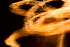 Abstract yellow firestorm. In the dark night Royalty Free Stock Photos