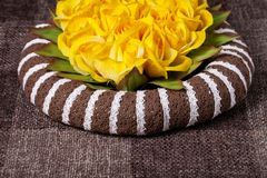 Abstract yellow flowers brown background Stock Images