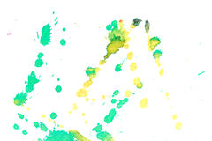 Abstract yellow green ink splash. Abstract two-color yellow green ink splash. Ink blots. Elements of design. The water-soluble ink on white paper Leste. Abstract Stock Photo