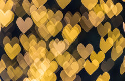 Abstract yellow hearts bokeh background Stock Photo