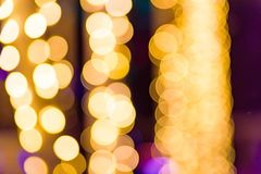 Abstract yellow holiday lights blur for festive background royalty free stock photo