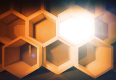 Abstract yellow honeycomb structure background. With light Stock Photography