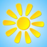 Abstract yellow paper sun on a blue background. Royalty Free Stock Photography
