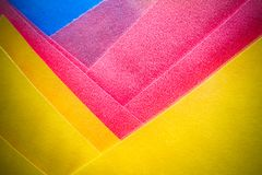 Abstract yellow, pink and blue coloured paper layers macro photo as colourful texture background Stock Image