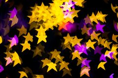 Abstract Yellow Purple lights Star bokeh background Royalty Free Stock Images