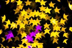Abstract Yellow Purple lights Star bokeh background Stock Photo