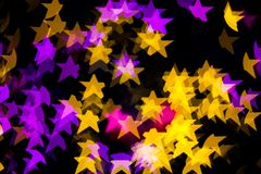 Abstract Yellow Purple lights Star bokeh background. Beautiful Abstract Yellow Purple lights bokeh background Royalty Free Stock Photography