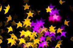 Abstract Yellow Purple lights Star bokeh background. Beautiful Abstract Yellow Purple lights bokeh background Royalty Free Stock Photo