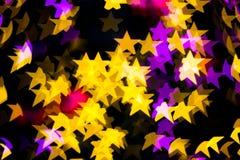 Abstract Yellow Purple lights Star bokeh background Stock Photos
