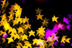 Abstract Yellow Purple lights Star bokeh background Stock Photography