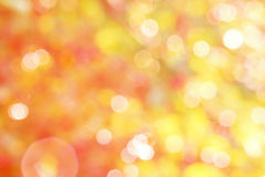 Abstract yellow and red background with white bokeh Royalty Free Stock Photography