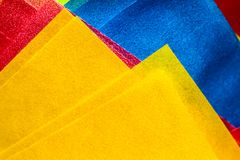 Abstract yellow, pink and blue coloured paper layers macro photo as colourful texture background Royalty Free Stock Photos