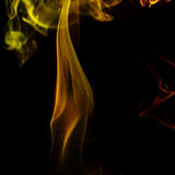 Abstract yellow smoke from the aromatic sticks. Royalty Free Stock Images