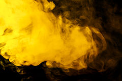 Abstract yellow smoke hookah on a black background. Stock Photo
