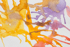 Abstract yellow,violet and red watercolor splash blot Stock Image