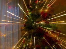 Abstract zoom effects with christmas tree lights. Abstract zoom effects with christmas tree warm lights and background royalty free stock image