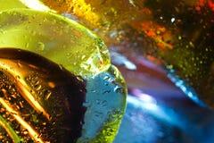 abstracte achtergrond. De dalingen van het glas van water. Stock Foto's