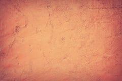 Abstracte achtergrond, de muur waarop het oranje pleister stock foto