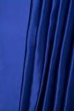 Abstracte achtergrond, gordijn blauwe stof. Stock Afbeelding