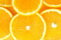 Abstracte achtergrond met citrusvrucht van oranje plakken Royalty-vrije Stock Fotografie