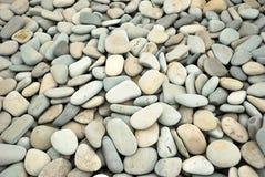 Abstracte achtergrond met droge ronde kiezelsteenstenen Stock Afbeelding