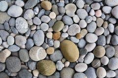 Achtergrond met ronde peeble stenen royalty-vrije stock afbeeldingen