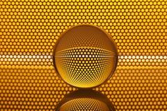 Abstracte achtergrond met glasbal en gouden (Engels) patroon Stock Foto's