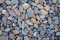 Abstracte achtergrond om kiezelsteenstenen in uitstekende stijl Royalty-vrije Stock Foto