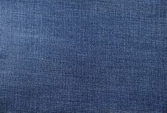 Abstracte achtergrond van donkerblauwe de stoffentextuur van Jean Stock Fotografie