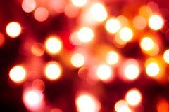 Abstracte achtergrond van lichten. Rode tint Royalty-vrije Stock Afbeeldingen