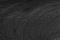 Abstracte achtergrond van zwarte natuurlijke houten eik voor uw uniek project stock foto's