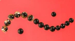 Abstracte achtergrond van zwarte parels Royalty-vrije Stock Foto's
