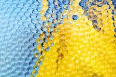 Abstracte blauwe en gele geweven glasachtergrond Stock Fotografie