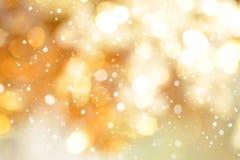 Abstracte bokeh gouden achtergrond met sneeuw Stock Afbeelding