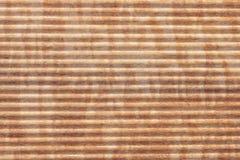 Abstracte bruine gestripte houten textuurachtergrond Royalty-vrije Stock Afbeeldingen
