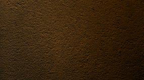 Abstracte bruine okkernootkleur met achtergrond van de muur de ruwe droge textuur royalty-vrije stock afbeeldingen