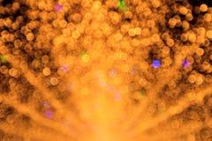 Abstracte cirkelbokehachtergrond met defocus van geel licht Royalty-vrije Stock Foto's