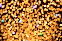 Abstracte cirkelbokehachtergrond met defocus van geel licht Stock Afbeeldingen