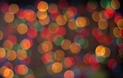 Abstracte cirkelbokehachtergrond van Kerstmislicht Stock Afbeeldingen