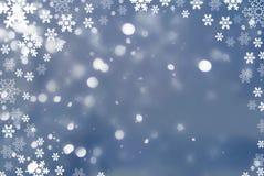 Abstracte de winterachtergrond van sneeuwvlokkerstmis Stock Afbeeldingen